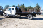 black hooklift roll off flat bed