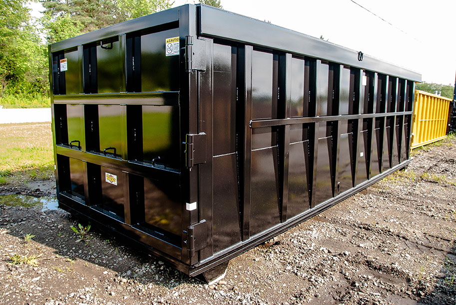 heavy duty black construction scrap hauling roll off container with 9 panel tail gate