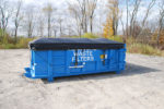 blue sealed roll off container with side roll tarp system