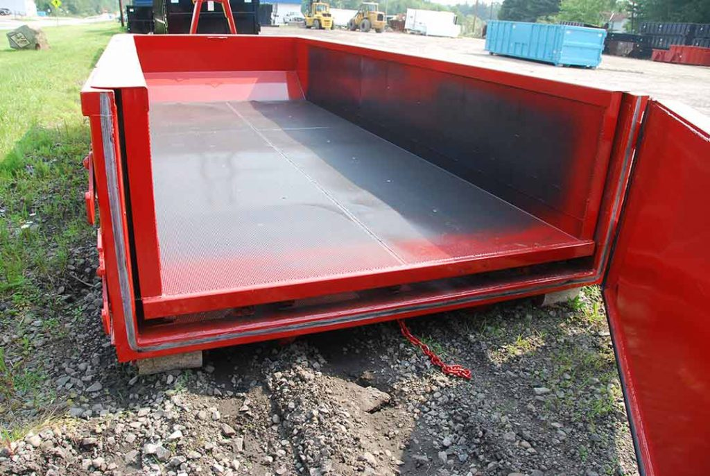 Red dewatering style roll-off container with hooklift hookup and open tailgate