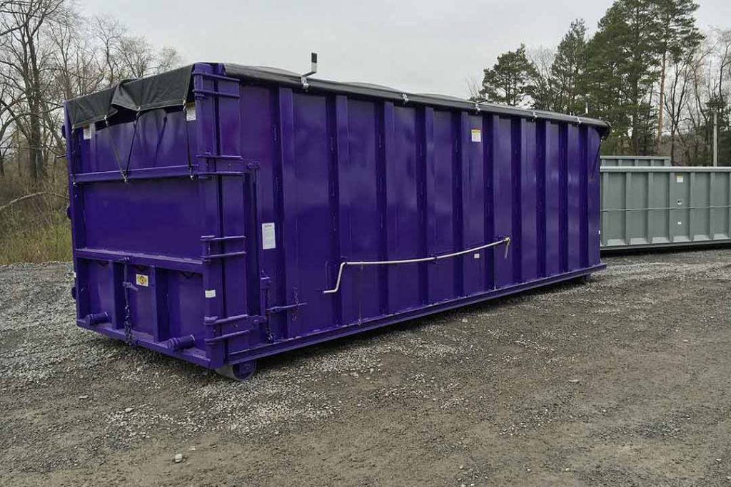 Purple dewatering container with side roll tarp system