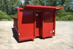 Red permanent mount dump body container with cab shield with cutout for exhaust