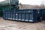 Blue dump body roll-off container with cable style hookup, push plate, and board pockets