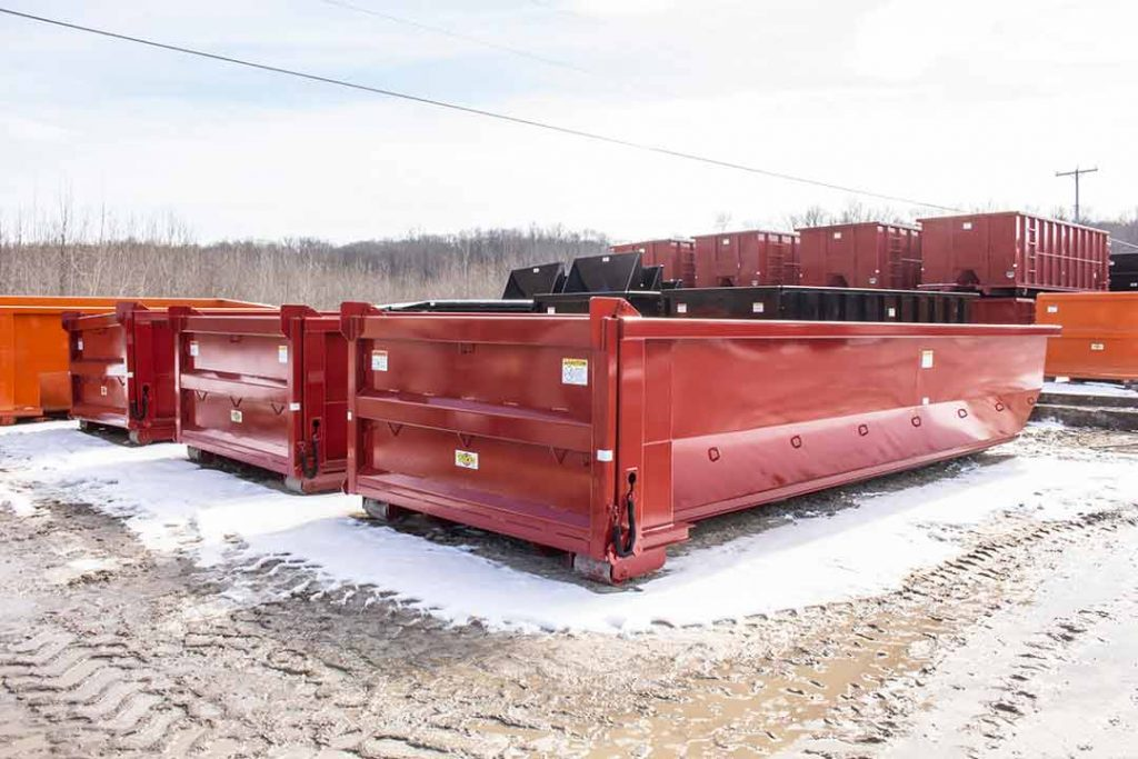 Red tub style dump body roll-off container with dump style tailgate