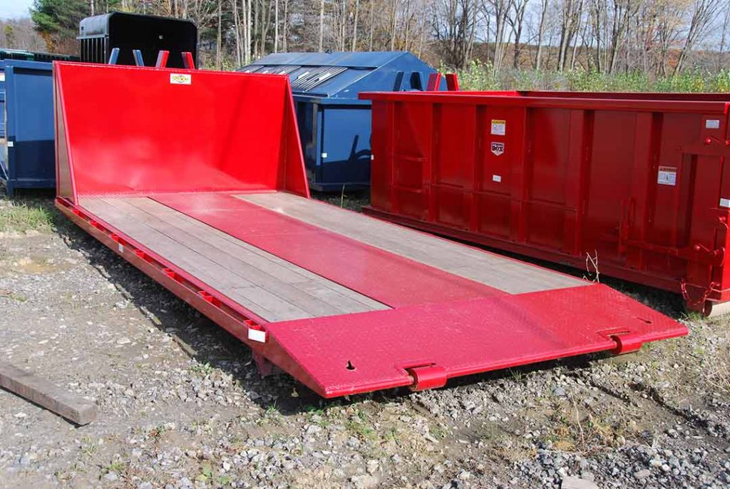 Red apitong style track on flatbed roll-off container with hooklift and beavertail