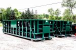 Green Poly Box rolloff container with Sign Plates, Push Plates, and Cable hookup