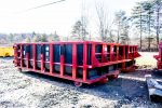 Red Poly Box rolloff container with custom Bumper Plate and cable hookup