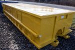 Yellow recycler style roll off container with flat style roof, metal sliding lids, and cable style hookup