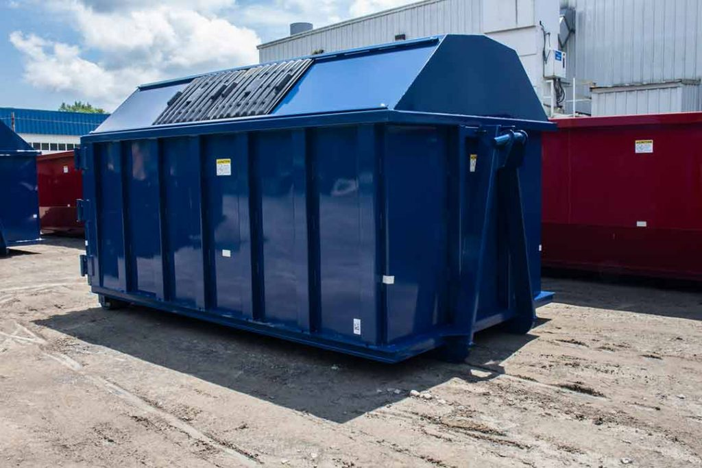 Blue recycler style roll off container with gambrel style roof, sliding lids, and hooklift style hookup