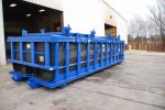 blue double rolling roof on a Poly Box roll-off container