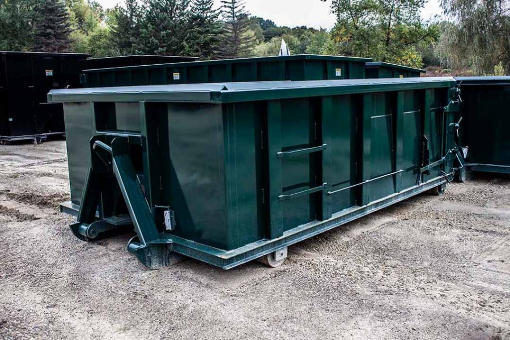 Green sealed style rolloff container with hooklift hookup and inverted angles