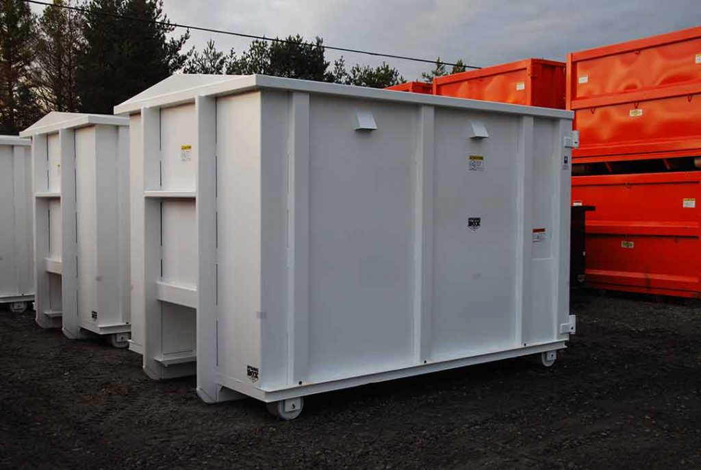 White security style rolloff container with cable style hookup, air vents, and security style doors
