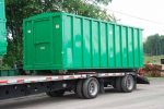 Green security style rolloff container with single security style door and cable style hookup