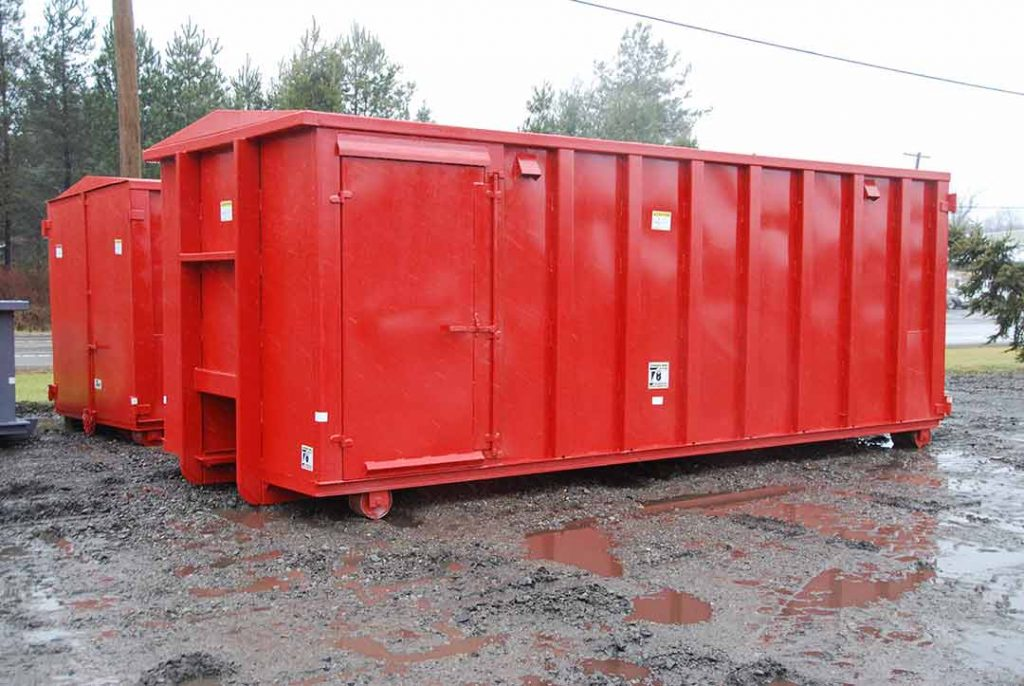 Red security style roll off container with cable hookup, security style doors and side door