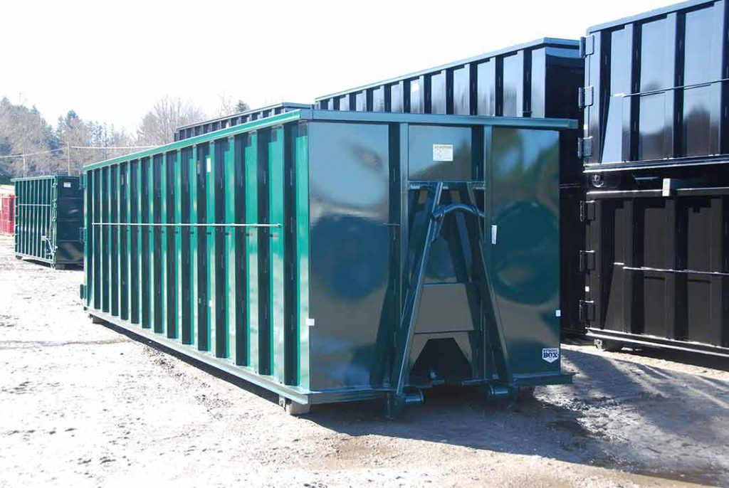 Green Strong Box rolloff container with cable and hooklift combo hookup