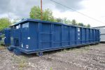 Blue Strong Box rolloff container with single side swing tailgate and cable style hookup