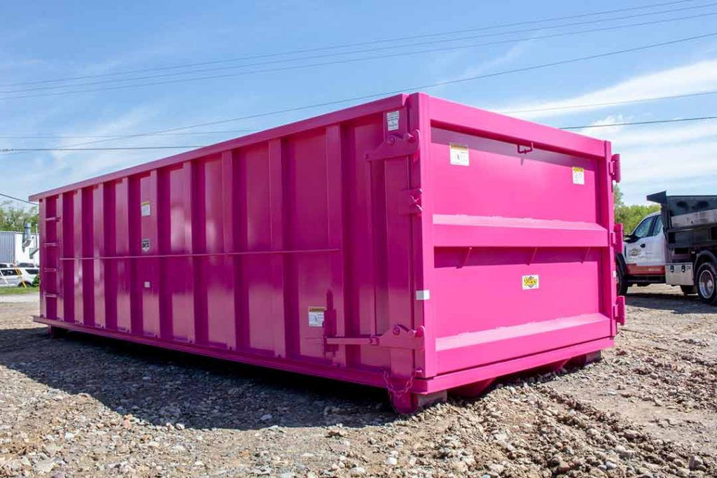 Pink Strong Box rollooff container with single side swing tailgate and cable style hookup
