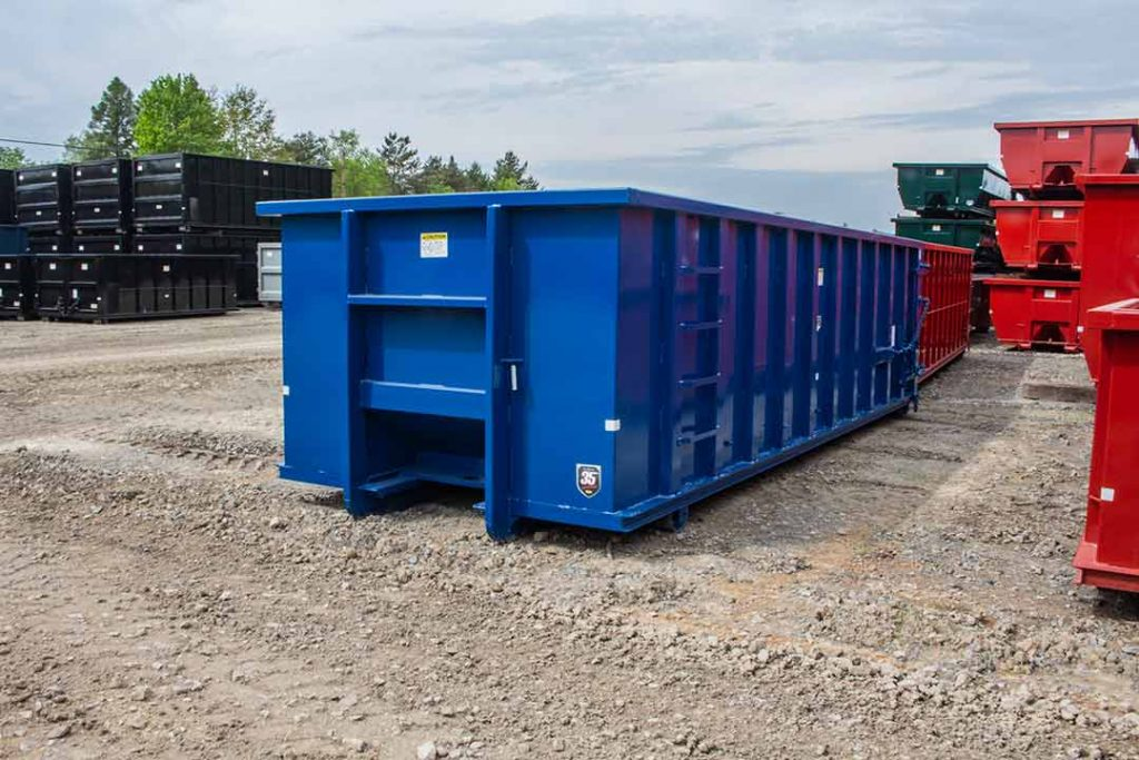 Blue Strong Box rolloff container with Canadian style hookup and sealed single side swing tailgate
