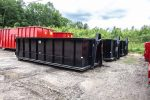 Black Strong Box rolloff container with single side swing container and hooklift style hookup