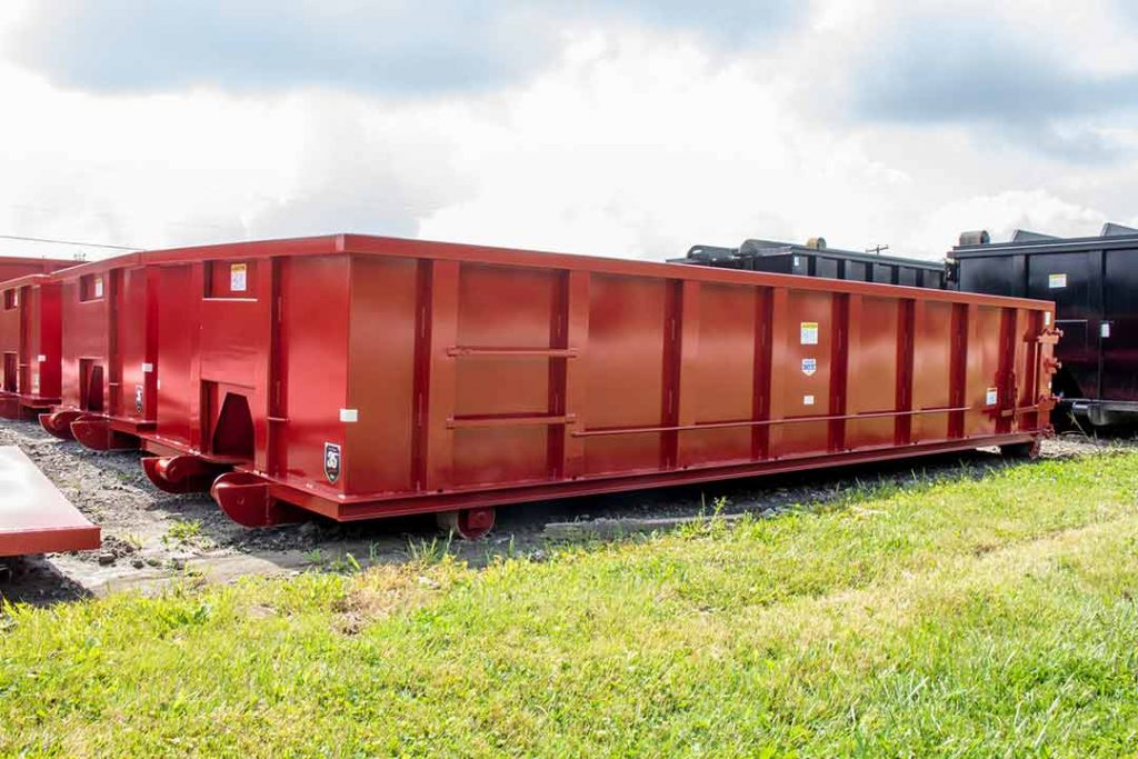 Red Tough Box rolloff containers in 20yd with cable style hookup and single side swing tailgate