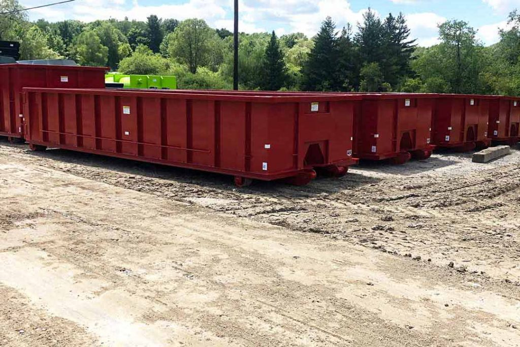 Red Tough Box rolloff containers with cable style hookup and in 20yd