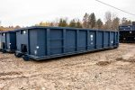 Blue Tough Box rolloff container with cable style hookup and single side swing tailgate