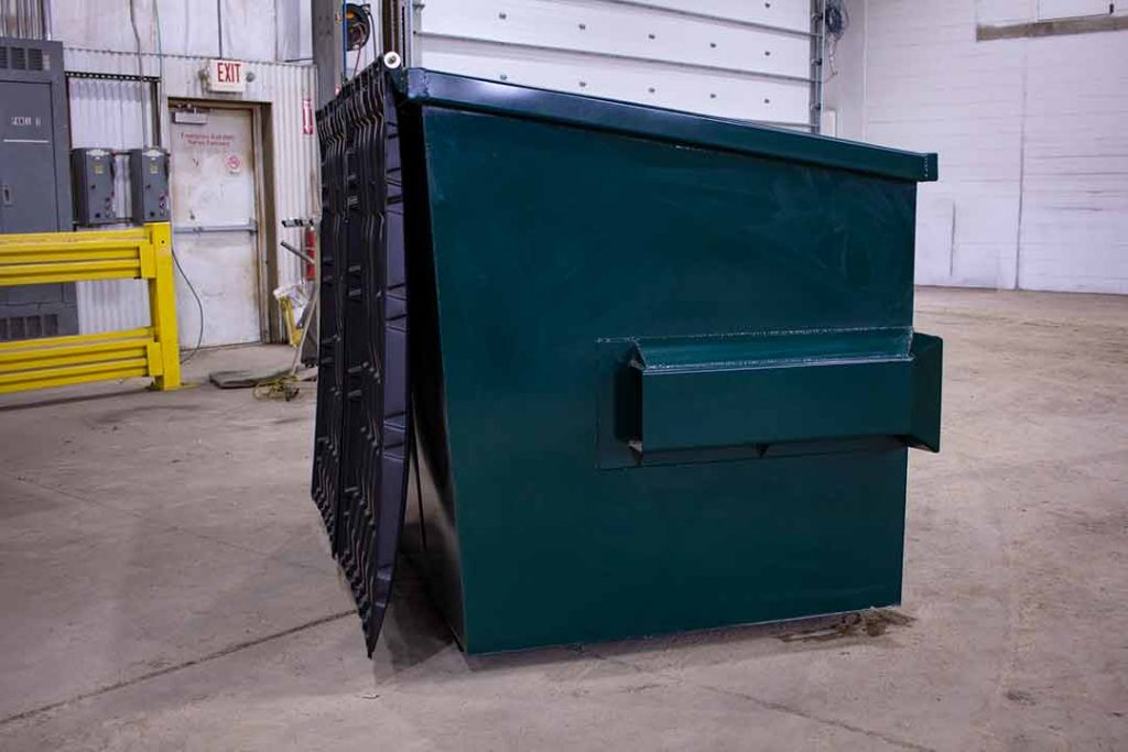 Green 4YD Trash Box side view small can front load container indoors with fork pockets and lids off