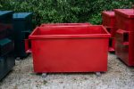 2YD Red Trash Box front load small can container out in the yard with fork pockets and no lids