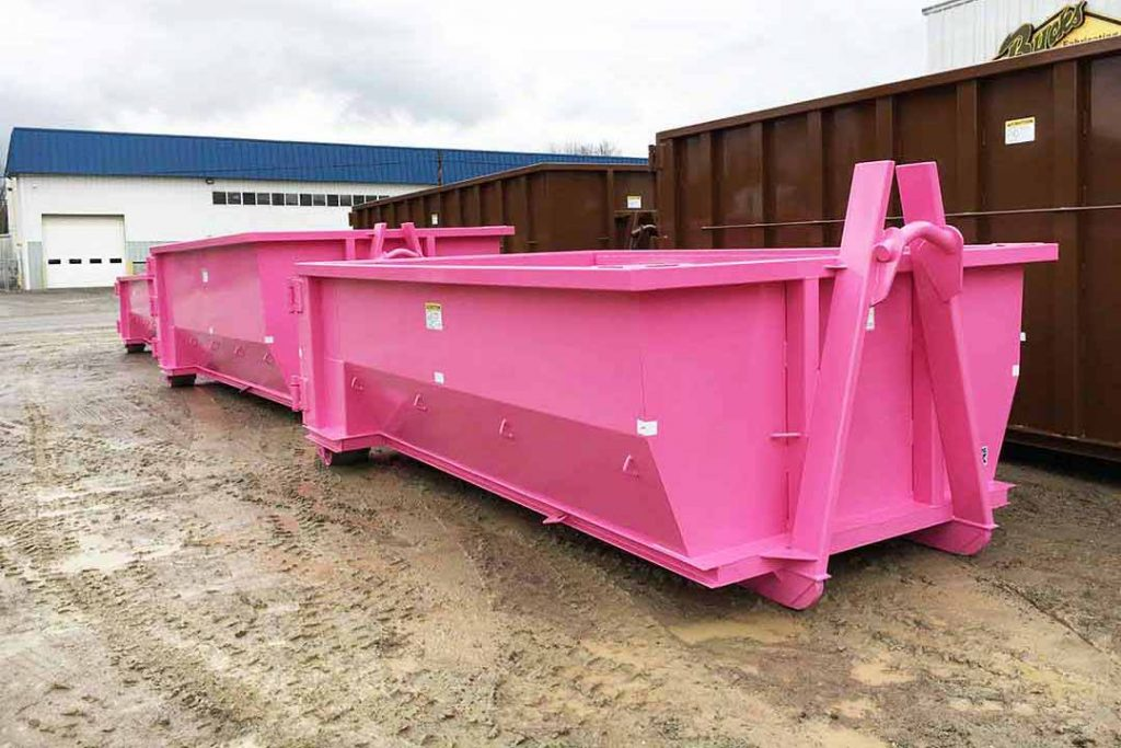 Pink tub style rolloff container with single swing tailgate and hooklift hookup