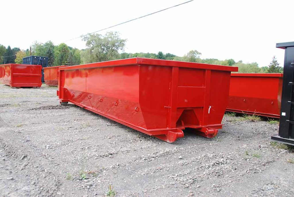 Red tub style rolloff container with single side swing tailgate and cable style hookup
