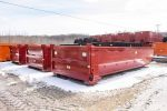 Red tub style rolloff containers with dump style tailgate and hooklift hookups