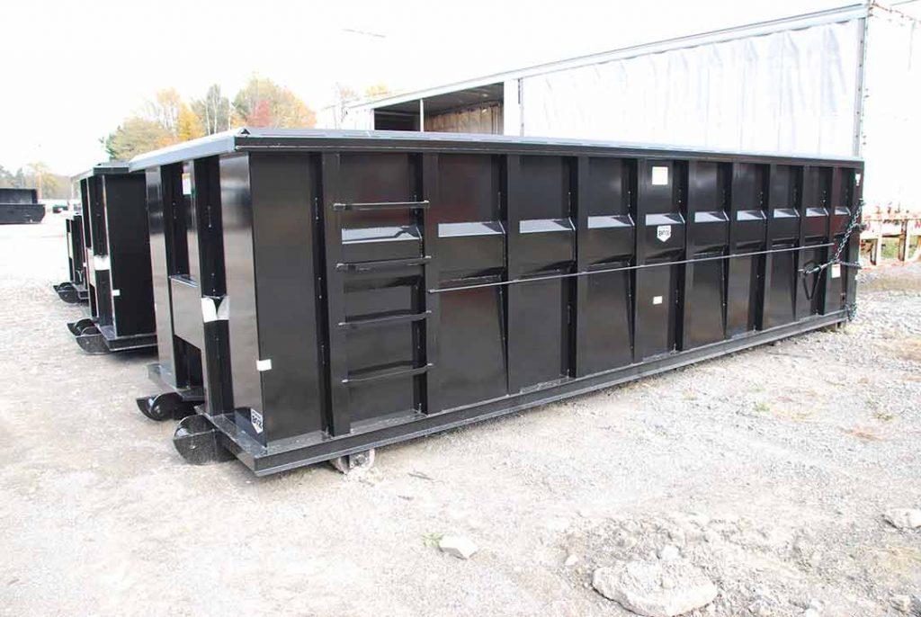 Black ultra box rolloff container with new york strips, inverted angle, side stiffeners, sealed style tailgate and cable hookup
