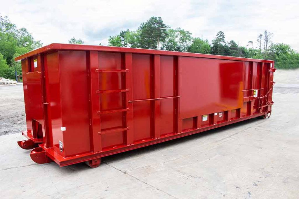 Red Ultra Box rolloff container with sign plates, push plate, cable style hookup, and sealed tailgate