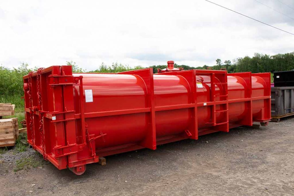 Red Vacuum Tank rolloff container with three pipe and nipple caps, one being on the manway door