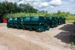 Green vacuum tank roll off containers with blind flanges on the bulkhead and cable style hookup