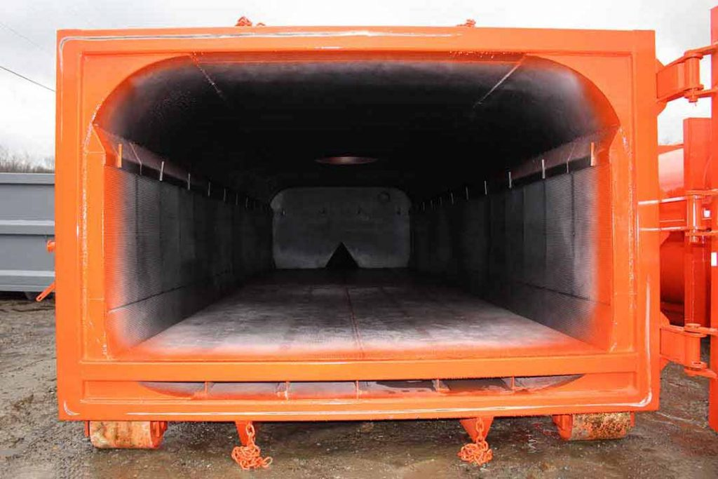 Orange vacuum tank rolloff container with removable dewatering basket